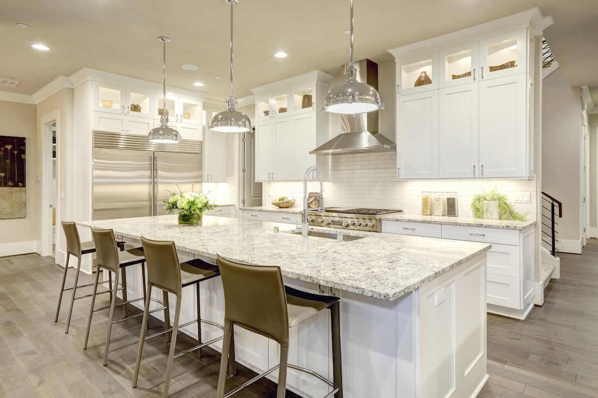 beautiful white modern kitchen at a kitchen design showroom