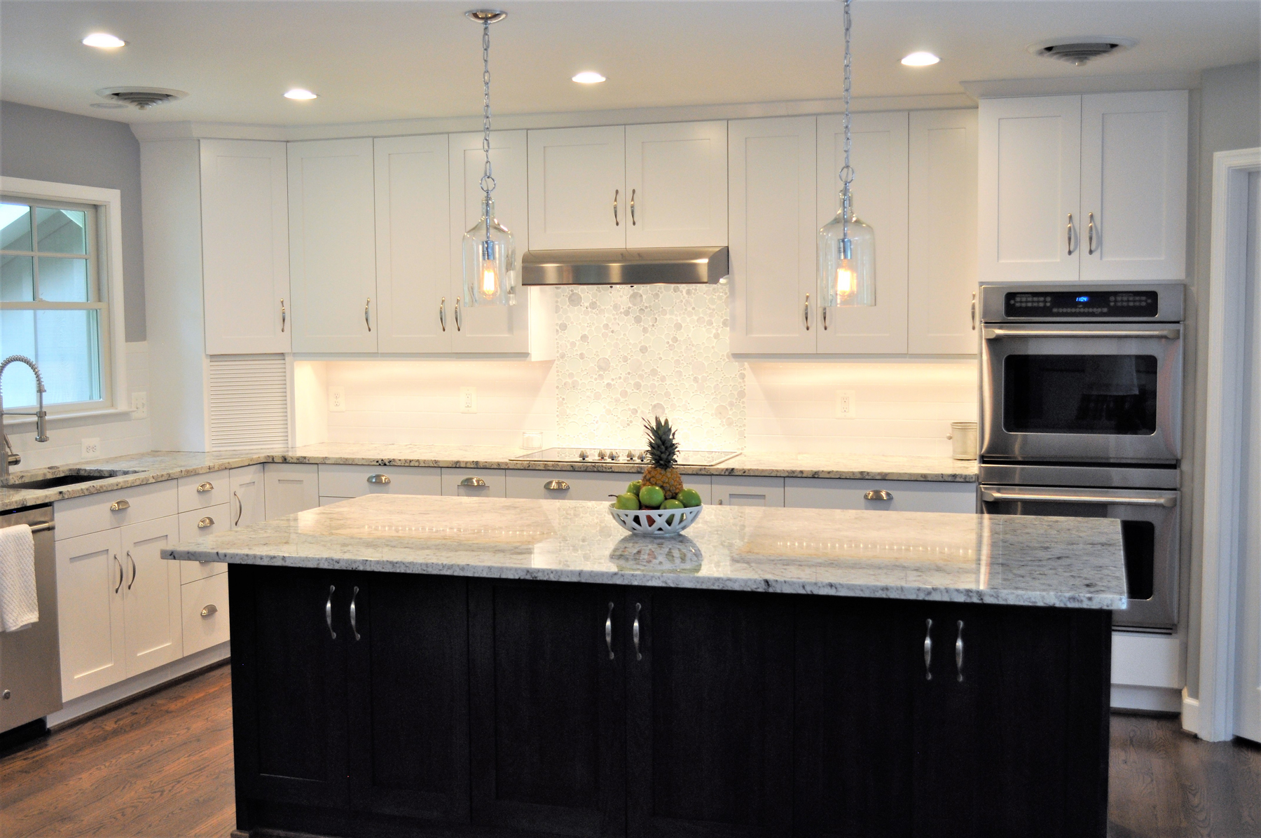 Full Kitchen Remodel with White Cabinets and Black Island in Montgomery County, MD